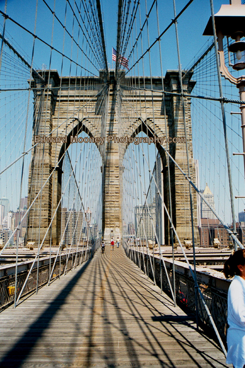 Walking the historical Brooklyn Bridge in NY. Ed Mooney took this photo of the Brooklyn Bridge years ago.